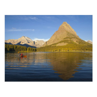 Kayaking in Swiftcurrent Lake at sunrise in the Postcard