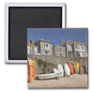 Kayaks and dinghies stacked against seawall at 2 inch square magnet