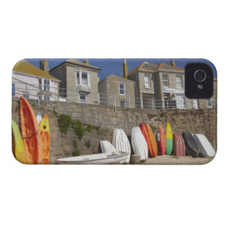 Kayaks and dinghies stacked against seawall at Case-Mate blackberry case