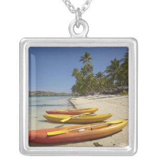 Kayaks on the beach, Plantation Island Resort Jewelry