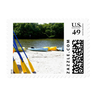 Kayaks on the beach stamp