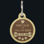 "Keep Calm and Call My Mom Round Large ID Dog Tag<br><div class=""desc"">&#169; Sunny Mars Designs. Brown and Beige Stripes Dog Paw and Bone Large Round Pet Dog Tag – Cute, stylish custom printed keep calm and call my mom 100% recycled steel customizable round large dog tag features a gorgeous, brown pinstripes design with a cream dog paw and dog bone with...</div>"