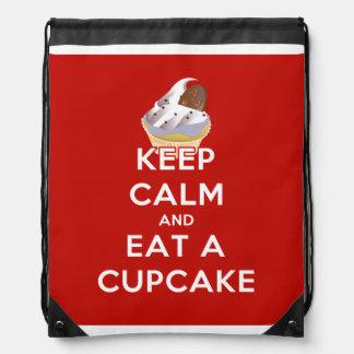 Keep Calm and Eat a Cupcake Drawstring Bag