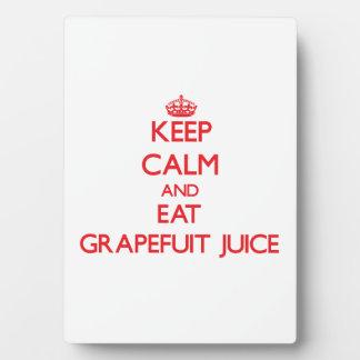 Keep calm and eat Grapefuit Juice Photo Plaques
