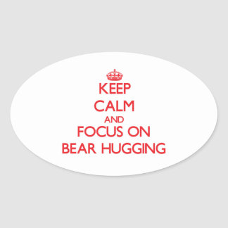 Keep Calm and focus on Bear Hugging Oval Sticker