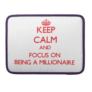 Keep Calm and focus on Being A Millionaire MacBook Pro Sleeve