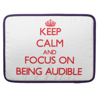 Keep calm and focus on BEING AUDIBLE MacBook Pro Sleeves