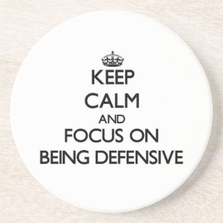 Keep Calm and focus on Being Defensive Drink Coasters
