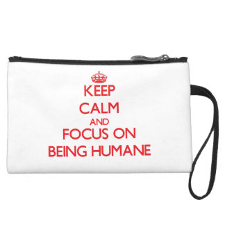Keep Calm and focus on Being Humane Wristlet