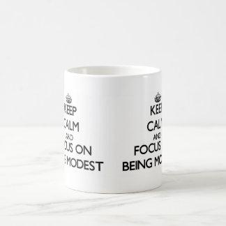Keep Calm and focus on Being Modest Mug
