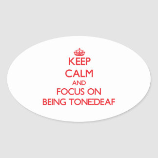 Keep Calm and focus on Being Tone-Deaf Oval Sticker