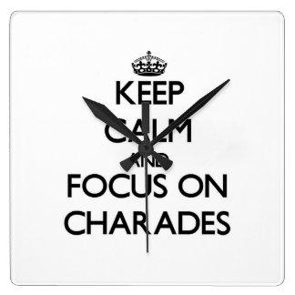 Keep Calm and focus on Charades Wall Clocks