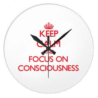 Keep Calm and focus on Consciousness Wall Clocks