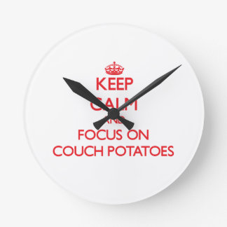 Keep Calm and focus on Couch Potatoes Wallclocks