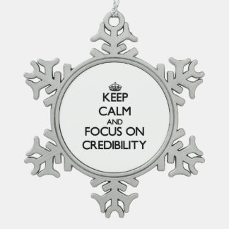 Keep Calm and focus on Credibility Snowflake Pewter Christmas Ornament