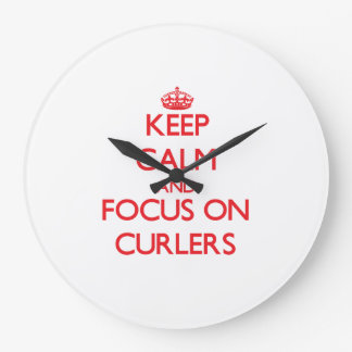 Keep Calm and focus on Curlers Wallclocks