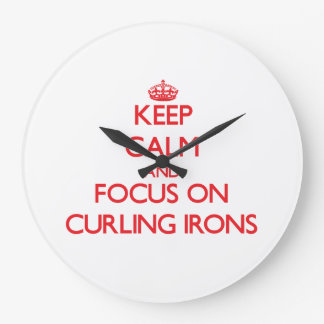 Keep Calm and focus on Curling Irons Wallclocks