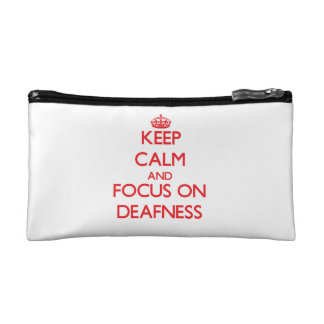 Keep Calm and focus on Deafness Cosmetic Bags