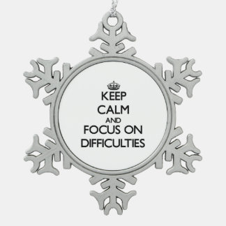 Keep Calm and focus on Difficulties Snowflake Pewter Christmas Ornament