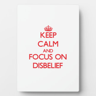 Keep Calm and focus on Disbelief Photo Plaques