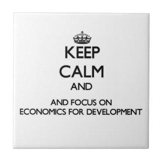 Keep calm and focus on Economics For Development Ceramic Tiles