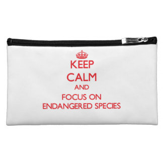 Keep Calm and focus on ENDANGERED SPECIES Cosmetics Bags