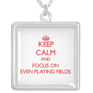 Keep Calm and focus on Even Playing Fields Necklaces