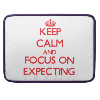 Keep Calm and focus on EXPECTING MacBook Pro Sleeves