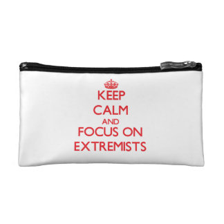 Keep Calm and focus on EXTREMISTS Makeup Bags