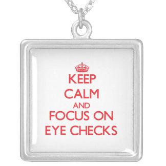 Keep Calm and focus on EYE CHECKS Pendants