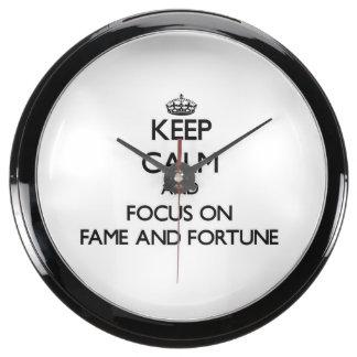 Keep Calm and focus on Fame And Fortune Aquarium Clock