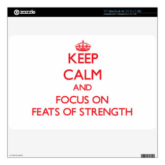 Keep Calm and focus on Feats Of Strength MacBook Skins