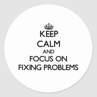 Keep Calm and focus on Fixing Problems Round Stickers