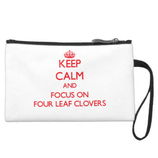 Keep Calm and focus on Four Leaf Clovers Wristlet Clutch