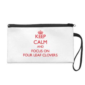 Keep Calm and focus on Four Leaf Clovers Wristlet Purse
