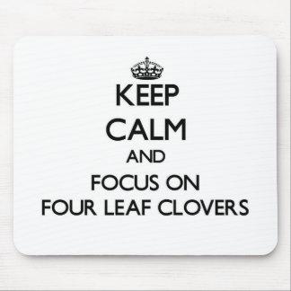 Keep Calm and focus on Four Leaf Clovers Mousepads