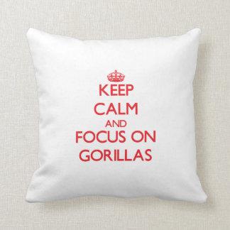 Keep calm and focus on Gorillas Throw Pillows