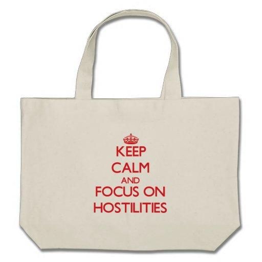Keep Calm and focus on Hostilities Tote Bags