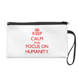 Keep Calm and focus on Humanity Wristlet Clutches
