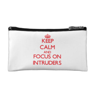 Keep Calm and focus on Intruders Cosmetic Bags