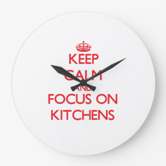 Keep Calm and focus on Kitchens Wall Clock