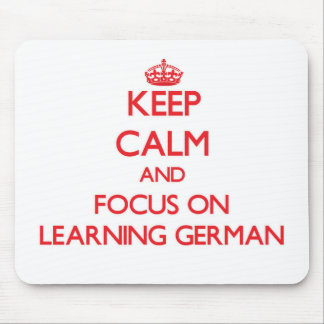 Keep Calm and focus on Learning German Mousepads