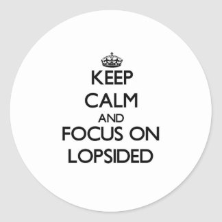 Keep Calm and focus on Lopsided Round Sticker