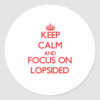 Keep Calm and focus on Lopsided Round Stickers