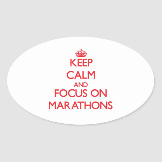 Keep Calm and focus on Marathons Oval Stickers