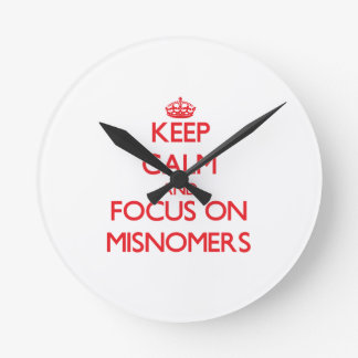 Keep Calm and focus on Misnomers Round Wall Clocks