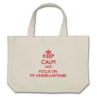 Keep Calm and focus on My Kindergartener Tote Bags