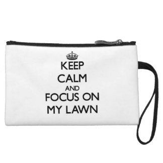 Keep Calm and focus on My Lawn Wristlet Clutches