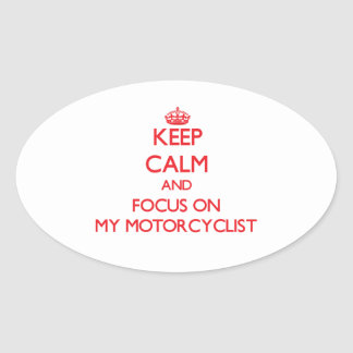Keep Calm and focus on My Motorcyclist Oval Sticker