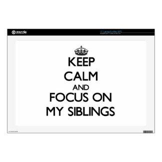 "Keep Calm and focus on My Siblings 17"" Laptop Skins"